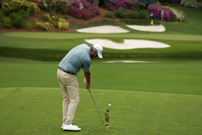 Marc Leishman, of Australia, hits his tee shot on the 12th hole during the second round of the Masters golf tournament on Friday, April 9, 2021, in Augusta, Ga. (AP Photo/Charlie Riedel)