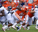 FILE - In this Sept. 15, 2018, file photo, Clemson's Clelin Ferrell (99) rushes into the backfield during the first half of an NCAA college football game against Georgia Southern, in Clemson, S.C. No. 2 Clemson once again dominated the Associated Press All-Atlantic Coast Conference teams and individual awards released Tuesday, Dec. 4, 2018. Clelin Ferrell is the defensive player of the year. (AP Photo/Richard Shiro, File)
