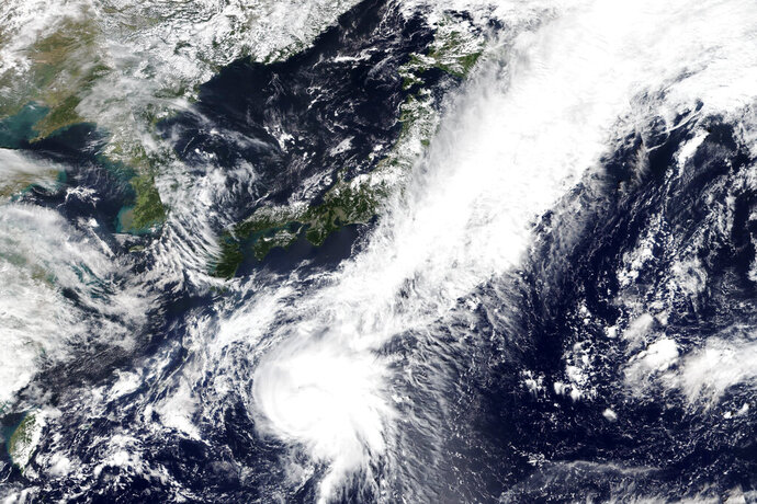 This Monday, Sept. 21, 2020, satellite image released by NASA Worldview, Earth Observing System Data and Information System (EOSDIS) shows Tropical Storm Dolphin moving northbound toward Japan. The tropical storm developing in the Pacific Ocean, was slowly sweeping toward Japan Tuesday, threatening the main island of Honshu with heavy rainfall and harsh winds. (NASA via AP)