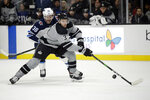 Los Angeles Kings' Matt Roy (3) controls the puck in front of Winnipeg Jets' Logan Shaw (38) during the first period of an NHL hockey game Saturday, Nov. 30, 2019, in Los Angeles. (AP Photo/Marcio Jose Sanchez)