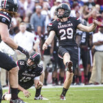 FILE - In this Sept. 17, 2016 file photo South Carolina place kicker Elliott Fry (29) and teammate Sean Kelly (13) watch the ball travel through the uprights during the first half of an NCAA college football game in Columbia, S.C. Elliott Fry and Eddy Pineiro alternate day by day performing the kicking duties for the Chicago Bears as they seek to replace former kicker Cody Parkey. Both have shown strong, accurate legs in the first practices, hitting from 60 yards or longer. (AP Photo/Sean Rayford, file)