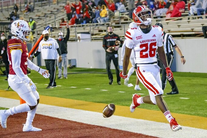 Louisiana-Lafayette wide receiver Kaleb Carter (26) releases the ball after scoring the team's final touchdown in a 70-20 victory over Louisiana-Monroe in an NCAA college football game in Monroe, La., Saturday, Nov. 28, 2020. (AP Photo/Matthew Hinton)