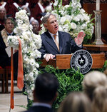 Texas Governor Greg Abbott delivers his words of remembrance for T. Boone Pickens during his funeral service at Highland Park United Methodist Church in Dallas, Thursday, Sept. 19, 2019. An Oklahoma State-colored tie left by longtime friend Alan White is draped across a white floral bouquet, left. (Tom Fox/The Dallas Morning News via AP, Pool)