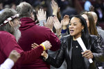 South Carolina coach Dawn Staley celebrates with fans after an NCAA college basketball game against Vanderbilt Monday, Feb. 17, 2020, in Columbia, S.C. South Carolina defeated Vanderbilt 95-44. (AP Photo/Sean Rayford)