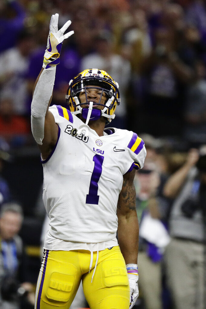 LSU wide receiver Ja'Marr Chase celebrates after scoring against Clemson during the first half of a NCAA College Football Playoff national championship game Monday, Jan. 13, 2020, in New Orleans. (AP Photo/Sue Ogrocki)