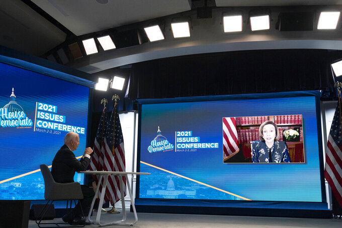"""FILE - In this Wednesday, March 3, 2021 file photo, President Joe Biden listens to House Speaker Nancy Pelosi of Calif., during a virtual meeting with the House Democratic caucus in the South Court Auditorium of the Eisenhower Executive Office Building, at the White House complex in Washington. On Friday, Sept. 2, 2021, The Associated Press reported on a manipulated video circulating online incorrectly asserting that after Biden offered to answer questions during the virtual meeting, Pelosi was caught saying, """"We don't want him to talk."""" The video clip that appears to show the awkward moment was actually manipulated and was first shared online with a label identifying it as satire. (AP Photo/Alex Brandon, File)"""