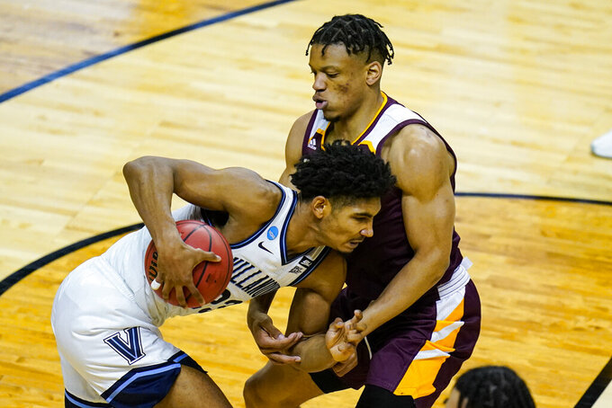 Villanova forward Jermaine Samuels (23) drives through Winthrop guard Micheal Anemia (3) in the first half of a first round game in the NCAA men's college basketball tournament at Farmers Coliseum in Indianapolis, Friday, March 19, 2021. (AP Photo/Michael Conroy)