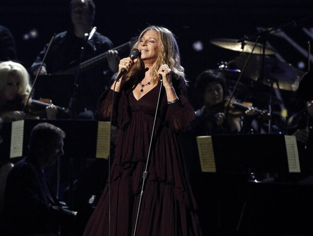 FILE - Barbara Streisand performs at the 53rd annual Grammy Awards in Los Angeles on Feb. 13, 2011. The Grammy Museum is launching its own online streaming service featuring performances and interviews from A-list musicians, as well as material from the museum's archive. About 40 programs will be available at the launch, including performances and interviews from Streisand, Billie EIllish and her producer-brother FINNEAS, Selena Gomez, Herb Alpert and Jerry Moss. (AP Photo/Matt Sayles, File)