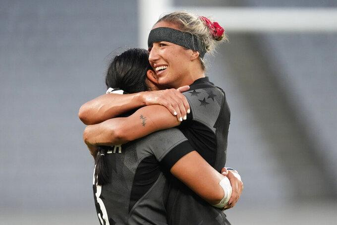 New Zealand's captain Sarah Hirini, right, hugs teammate Stacey Fluhler after winning gold in women's rugby sevens at the 2020 Summer Olympics, Saturday, July 31, 2021 in Tokyo, Japan. (AP Photo/Shuji Kajiyama)