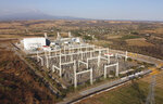 A newly built power generation plant is seen with the Popocatepetl Volcano in the background near Huexca, Morelos state, Mexico, Saturday, Feb. 22, 2020. The power plant is part of a mega-energy project that includes a natural gas pipeline that traverses three states. (AP Photo/Eduardo Verdugo)