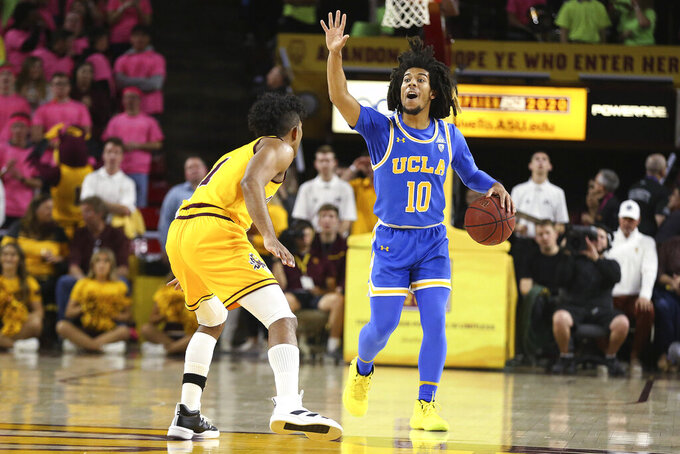 UCLA's Tyger Campbell (10) calls out a play at midcourt while being covered by Arizona State's Remy Martin (1) during the first half of an NCAA college basketball game Thursday, Feb. 6, 2020, in Tempe, Ariz. (AP Photo/Darryl Webb)