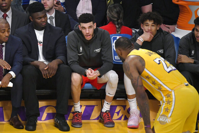 Los Angeles Lakers forward LeBron James, right, talks with New Orleans Pelicans forward Zion Williamson, left, and guard Lonzo Ball during the second half of an NBA basketball game Friday, Jan. 3, 2020, in Los Angeles. The Lakers won 123-113. (AP Photo/Mark J. Terrill)
