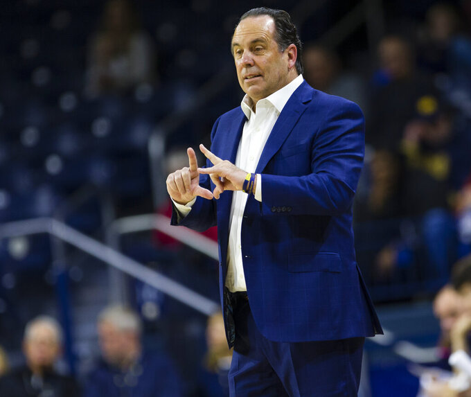 Notre Dame head coach Mike Brey calls a play during an NCAA college basketball game against Howard Tuesday, Nov. 12, 2019 at Purcell Pavilion in South Bend, Ind. (Michael Caterina/South Bend Tribune via AP)
