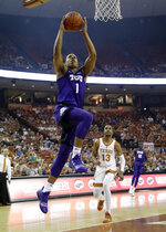 TCU guard Desmond Bane (1) drives to the basket past Texas guard Jase Febres (13) during the first half of an NCAA college basketball game, Saturday, March 9, 2019, in Austin, Texas. (AP Photo/Eric Gay)