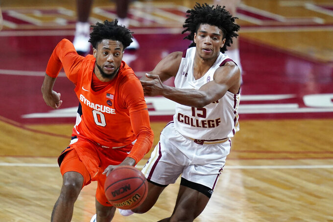 Syracuse forward Alan Griffin (0) controls the ball as Boston College guard Demarr Langford Jr. (15) defends during the second half of an NCAA college basketball game, Saturday, Dec. 12, 2020, in Boston. Syracuse won 101-63. (AP Photo/Elise Amendola)