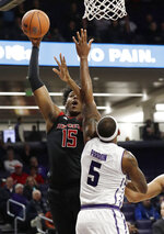 Rutgers forward/center Myles Johnson, left, shoots against Northwestern center Dererk Pardon during the first half of an NCAA college basketball game Wednesday, Feb. 13, 2019, in Evanston, Ill. (AP Photo/Nam Y. Huh)