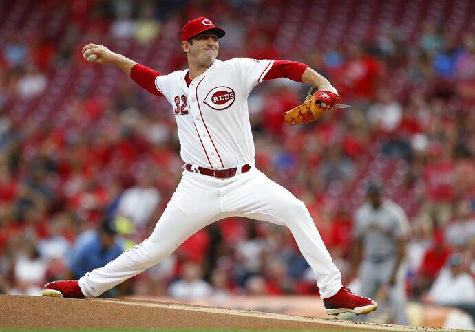 Cincinnati Reds starting pitcher Matt Harvey throws to a San Francisco Giants batter during the first inning of a baseball game Saturday, Aug. 18, 2018, in Cincinnati. (AP Photo/Gary Landers)