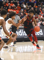 Stanford's Daejon Davis, right, tries to avoid Oregon State's Ethan Thompson, center, and Stephen Thompson Jr., left, during the first half of an NCAA college basketball game in Corvallis, Ore., Thursday, Feb. 7, 2019. (AP Photo/Amanda Loman)