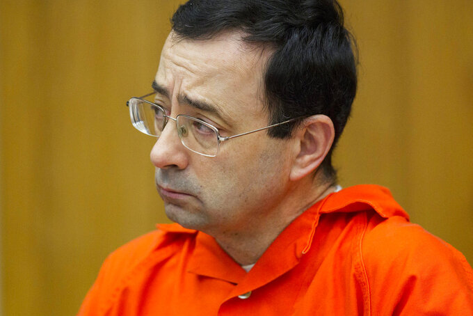 FILE - In this Jan. 31, 2018, file photo, Larry Nassar appears for his sentencing at Eaton County Circuit Court in Charlotte, Mich.  (Cory Morse/The Grand Rapids Press via AP, File)