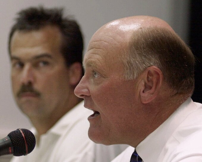 FILE — In this July 6, 2000, file photo, Tennessee Titans general manager Floyd Reese, right, speaks during a news conference in Nashville, Tenn. Titans head coach Jeff Fisher is at left. The Titans announced July 14, 2021, that Reese, Fisher, and former Houston Oiler head coach Bum Phillips will be the newest members of the Tennessee Titans' ring of honor. (AP Photo/Mark Humphrey)