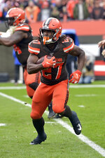 Cleveland Browns running back Kareem Hunt (27) rushes against the Buffalo Bills during the first half of an NFL football game, Sunday, Nov. 10, 2019, in Cleveland. (AP Photo/David Richard)