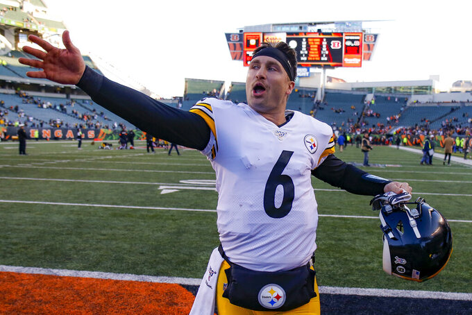 Pittsburgh Steelers quarterback Devlin Hodges reacts after winning an NFL football game against the Cincinnati Bengals, Sunday, Nov. 24, 2019, in Cincinnati. (AP Photo/Gary Landers)