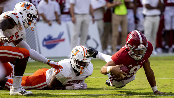 Alabama quarterback Bryce Young (9) dives for one more yard against Mercer during the first half of an NCAA college football game, Saturday, Sept. 11, 2021, in Tuscaloosa, Ala. (AP Photo/Vasha Hunt)