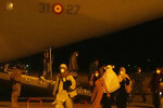 People arrive on a Spanish Air Force plane carrying Spanish nationals and Afghans at the Torrejon military base as part of the evacuation process in Madrid, Spain, Thursday, Aug. 19, 2021. (AP Photo/Paul White)