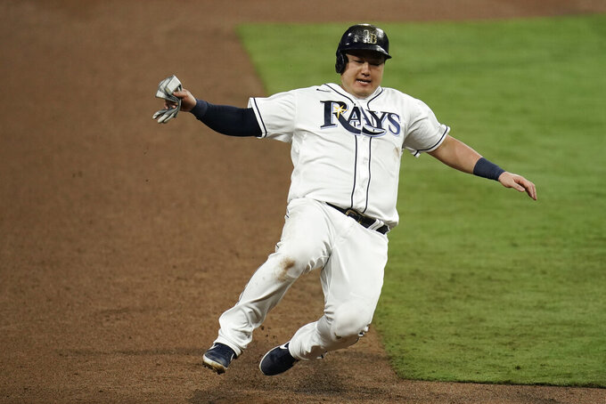 FILE - In this Oct. 17, 2020, file photo, Tampa Bay Rays' Ji-Man Choi advances to third on a sacrifice fly by Joey Wendle during the sixth inning in Game 7 of the baseball American League Championship Series against the Houston Astros in San Diego. Choi and the Rays argued their salary arbitration case Thursday, Feb. 4. The 29-year-old asked for a raise to $2.45 million, and the Rays argued for $1.85 million. A decision is expected Friday from Margaret Brogan, Gary Kendellen and Brian Keller, who heard the case over Zoom. (AP Photo/Gregory Bull, File)