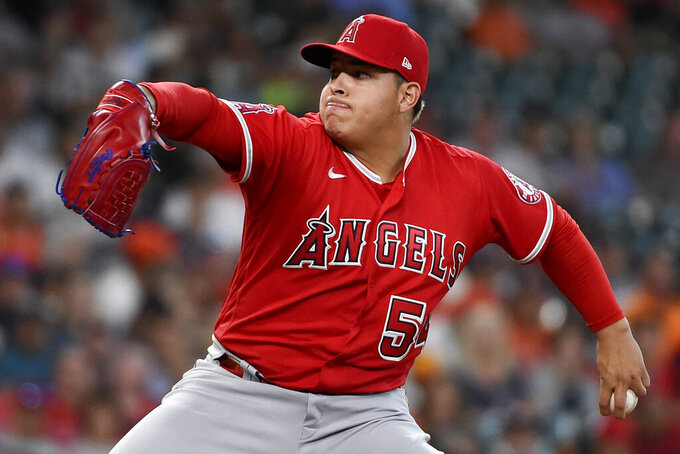 Los Angeles Angels starting pitcher Jose Suarez delivers during the first inning of a baseball game against the Houston Astros, Saturday, Sept. 11, 2021, in Houston. (AP Photo/Eric Christian Smith)
