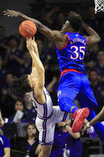 Kansas center Udoka Azubuike (35) blocks a shot by Kansas State guard Mike McGuirl (00) during the first half of an NCAA college basketball game in Manhattan, Kan., Saturday, Feb. 29, 2020. (AP Photo/Orlin Wagner)