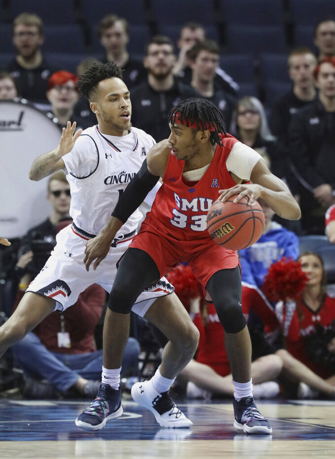 SMU's Jimmy Whitt is defended by Cincinnati's Jarron Cumberland during the first half of an NCAA college basketball game at the American Athletic Conference men's tournament Friday, March 15, 2019, in Memphis, Tenn. (AP Photo/Troy Glasgow)