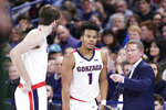 Gonzaga head coach Mark Few, right, speaks with guard Admon Gilder, center, and forward Drew Timme during the first half of an NCAA college basketball game in Spokane, Wash., Tuesday, Nov. 12, 2019. (AP Photo/Young Kwak)