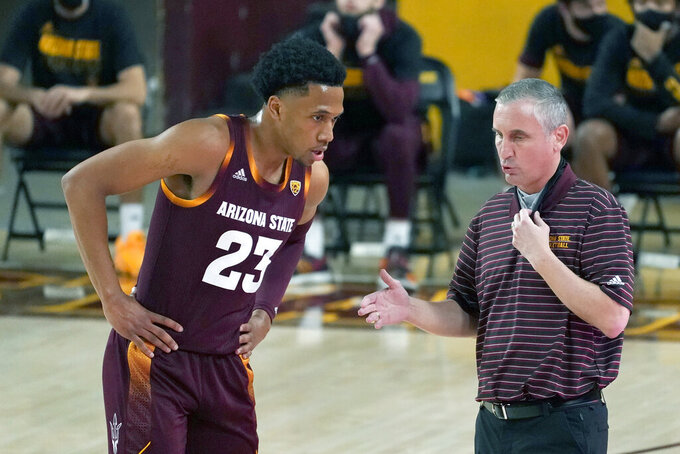 FILE - In this Jan. 21, 2021, file photo, Arizona State coach Bobby Hurley talks to Marcus Bagley during the first half of the team's NCAA college basketball game against Arizona in Tempe, Ariz. Arizona State lacked chemistry and consistency a year ago, causing the Sun Devils to labor through the 2020-21 season. Seeking a change, Hurley overhauled the roster in hopes of getting the Sun Devils back into the NCAA tournament. Bagley opted to return to Arizona State after initially entering the transfer portal. (AP Photo/Rick Scuteri, File)