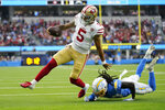 San Francisco 49ers quarterback Trey Lance (5) runs around Los Angeles Chargers defensive back Tevaughn Campbell (20) on a a failed two-point conversion attempt during the first half of a preseason NFL football game Sunday, Aug. 22, 2021, in Inglewood, Calif. (AP Photo/Ashley Landis)