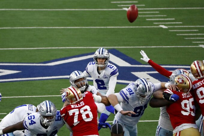 Dallas Cowboys place kicker Greg Zuerlein (2) kicks a field goal to make the score 27-24 against the San Francisco 49ers in the second half of an NFL football game in Arlington, Texas, Sunday, Dec. 20, 2020. The Cowboys won the game, 41-33. (AP Photo/Roger Steinman)