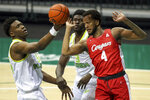 South Florida's Russel Tchewa, left, grabs a rebound in front of Houston's Justin Gorham (4) as South Florida's Prince Oduro (3) looks on during the first half of an NCAA college basketball game Wednesday, Feb. 10, 2021, in Tampa, Fla. (AP Photo/Mike Carlson)