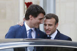 Canadian Prime Minister Justin Trudeau, left, says goodbye to French President Emmanuel Macron after a meeting at the Elysee Palace in Paris, Monday, April 16, 2018. (AP Photo/Michel Euler)