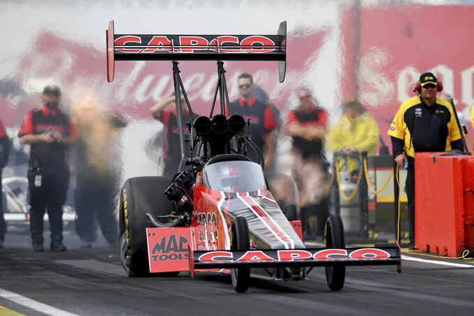 In this photo provided by the NHRA, Steve Torrence drives in Top Fuel qualifying Friday, Feb. 21, 2020, at the NHRA Arizona Nationals drag races in Chandler, Ariz. Torrence took the provisional No. 1 spot with a 3.671-second pass at 326.48 mph. (Marc Gewertz/NHRA via AP)