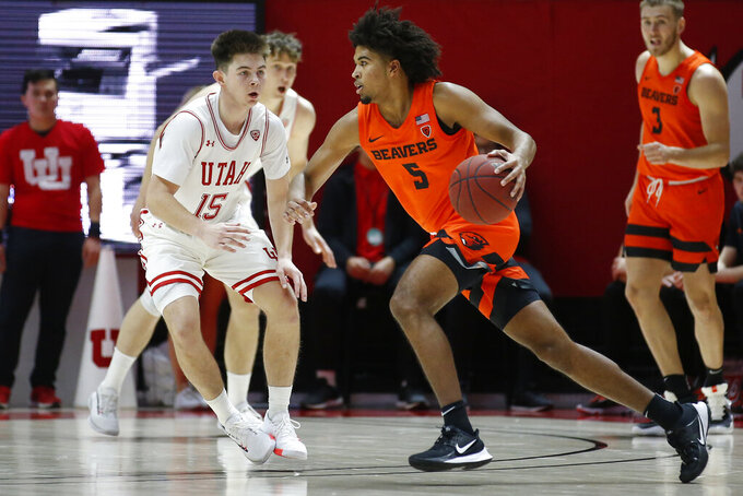 Oregon State guard Ethan Thompson (5) drives as Utah guard Rylan Jones (15) defends in the second half during an NCAA college basketball game Thursday, Jan. 2, 2020, in Salt Lake City. (AP Photo/Rick Bowmer)