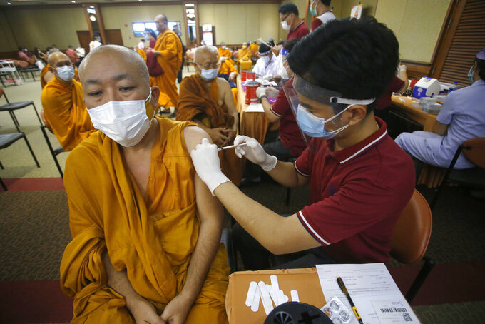 FILE - In this May 18, 2021, file photo, a health worker administers a dose of the Sinovac COVID-19 vaccine to Buddhist monk at Priest Hospital in Bangkok, Thailand. Thailand on Friday said it had detected its first locally transmitted cases of the coronavirus variant first found in India, even as it announced the formal rollout of its national vaccination plan from next month. (AP Photo/Anuthep Cheysakron,File)