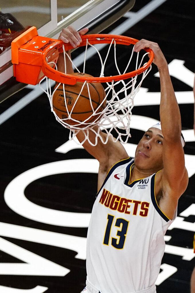 Denver Nuggets guard R.J. Hampton scores against the Atlanta Hawks during the second half of an NBA basketball game Sunday, Feb. 21, 2021, in Atlanta. (AP Photo/John Bazemore)