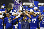 San Jose State players celebrate after defeating Boise State in an NCAA college football game for the Mountain West championship, Saturday, Dec. 19, 2020, in Las Vegas. (AP Photo/John Locher)