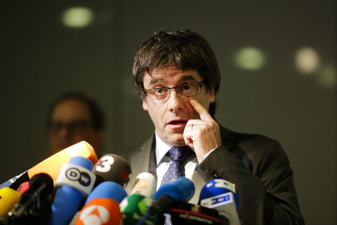 FILE - In this May 15, 2018 file photo former Catalan leader, Carles Puigdemont, addresses the media during a news conference in Berlin, Germany. A German court on Thursday, July 12, 2018 decided that he can be extradited to Spain on breach of trust charges but denied the extradition on charges of rebellion.  (AP Photo/Markus Schreiber, file)