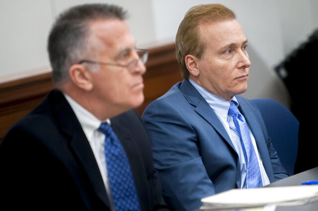 FILE - In this Jan. 28, 2019, file photo, Rene Boucher, right, and his attorney Matt Baker listen to questions during jury selection in a civil trial in Warren Circuit Court in Bowling Green, Ky. Boucher, U.S. Sen. Rand Paul's former neighbor, was resentenced Monday, July 27, 2020, to an extra seven months behind bars and six months in home detention for tackling and injuring the Kentucky lawmaker in anger over lawn care. (Bac Totrong/Daily News via AP, File)