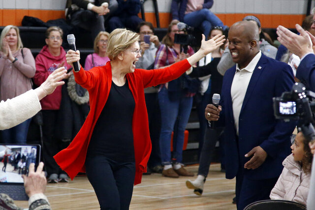 Democratic presidential candidate Sen. Elizabeth Warren, D-Mass., arrives for a town hall meeting Sunday, Jan. 26, 2020, in Davenport, Iowa. (AP Photo/Sue Ogrocki)