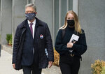 India Oxenberg, right, arrives with her attorney at Brooklyn federal court for a sentencing hearing for self-improvement guru Keith Raniere, Tuesday, Oct. 27, 2020 in New York. Raniere, whose organization NXIVM attracted millionaires and actresses among its adherents, is expected to be sentenced Tuesday on convictions that he turned some female followers into sex slaves branded with his initials. (AP Photo/Mark Lennihan)