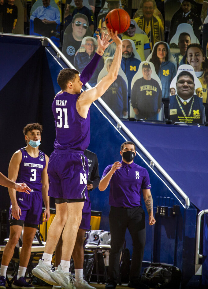 Northwestern forward Robbie Beran (31) attempts a three-point basket in the second half of an NCAA college basketball game against Michigan at Crisler Center in Ann Arbor, Mich., Sunday, Jan. 3, 2021. (AP Photo/Tony Ding)