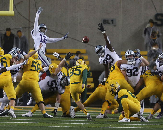 Baylor's John Mayers (95) kicks the go-ahead field goal over Kansas State in the final seconds of an NCAA college football game Saturday, Nov. 28, 2020, in Waco, Texas. (Rod Aydelotte/Waco Tribune Herald via AP)/