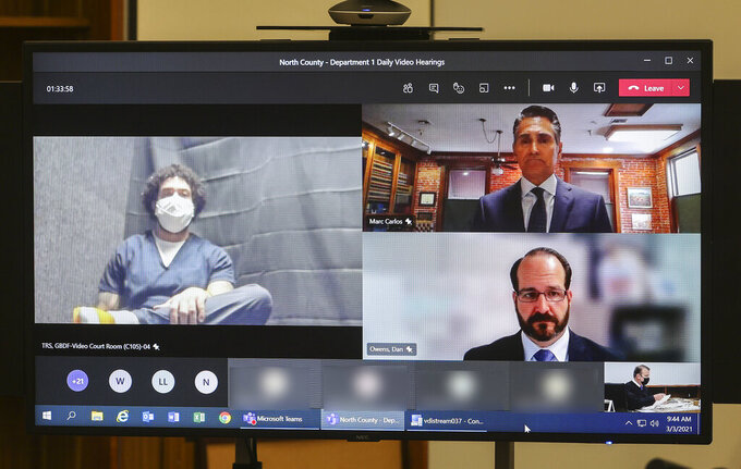 Kellen Winslow II, left, appears on video for his sentencing at the Superior Court North County Division on Wednesday, March 3, 2021 in Vista, Calif. Top right is Winslow defense attorney Marc Carlos and (bottom right) is Deputy District Attorney Dan Owens. Winslow was sentenced to 14 years in prison on rape and other charges. (Eduardo Contreras/The San Diego Union-Tribune via AP, Pool)